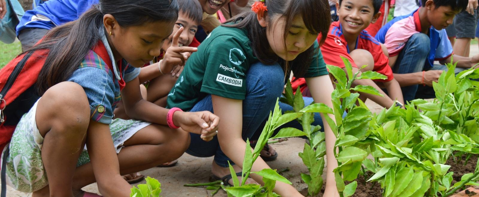 Besides childcare work in Cambodia, volunteers on a group trip will also help with light renovation work like planting a vegetable garden.